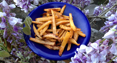Oven-baked rutabaga fries -- set amidst the wisteria on my deck